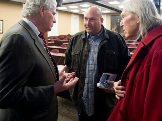 Gary Wade, Dean at Lincoln Memorial University's Duncan School of Law, speaks with Gatlinburg resident Erik Cooper, center, and Robert Hill during a symposium on Thursday, March 16, 2017, about the recent wildfires in Gatlinburg and the Smokies.