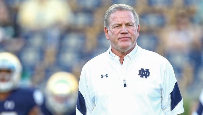 Sep 17, 2016; South Bend, IN, USA; Notre Dame Fighting Irish head coach Brian Kelly stands on the field prior to a game against the Michigan State Spartans at Notre Dame Stadium. Mandatory Credit: Mike Carter-USA TODAY Sports