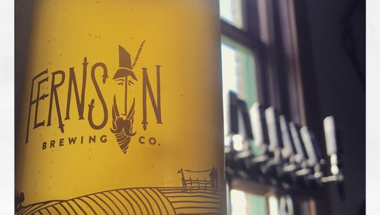 A glass of Fernson's Berliner Weisse with eight taps