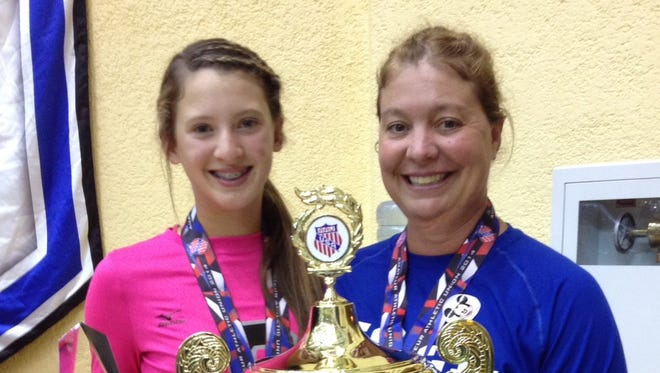Enka freshman Kloyee Anderson, left, and Xcel Volleyball Performance coach Kelly Risley.