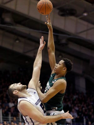Michigan State forward Deyonta Davis, right, shoots over Northwestern center Alex Olah during the first half Thursday night in Evanston. Davis finished with eight points on 4 of 7 shooting, and tallied 11 rebounds, six blocks and three assists.