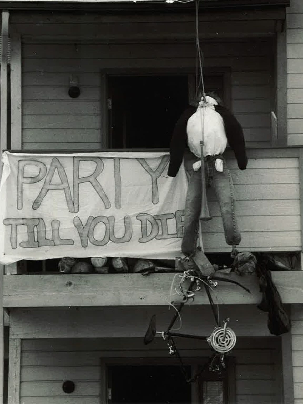 A dummy and sign hang from a balcony of the Baystone
