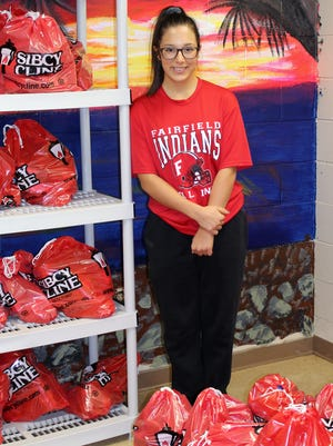Fairfield High School senior Madi Dunn started the Fairfield Food Closet with support from the school's National Honor Society, who hosts food drives and helps prepare the bags of food and toiletries.