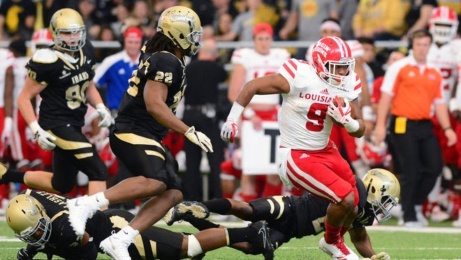 Ragin' Cajuns running back Trey Ragas finds space in the Idaho secondary during UL's 21-16 win Saturday.