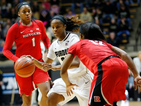 April Wilson runs throught the Rutgers press Thursday,