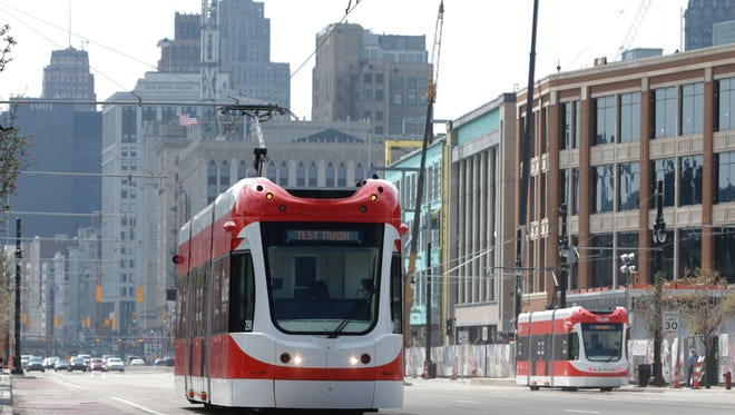 The QLINE heads north on Woodward passing by the Little Caesars Arena in Detroit on Tuesday, April 11, 2017, before service is launched in May.