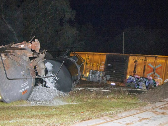 This photo made available by Polk County Fire Rescue, Fla., shows molten sulfur that spilled from a derailed train, Monday, Nov. 27, 2017. State officials are investigating the crash.