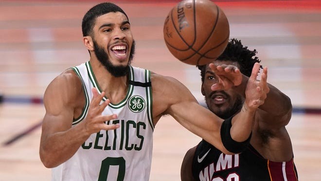 Boston's Jayson Tatum, left, and Miami's Jimmy Butler battle for a rebound during the second half of Sunday's Game 6 of the Eastern Conference final in Lake Buena Vista, Fla.
