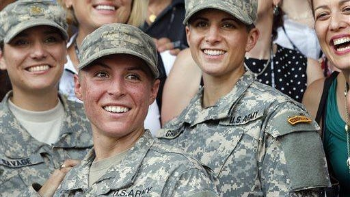 In this Aug. 21 photo, Army 1st Lt. Shaye Haver, center, and Capt. Kristen Griest, right, pose for photos with other female West Point alumni after an Army Ranger school graduation ceremony at Fort Benning, Ga.