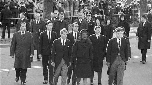 President John F. Kennedy's widow and his brothers arrive for the funeral Mass at St. Matthew's Cathedral in Washington, Nov. 25, 1963. In front are Robert F. Kennedy, Jacqueline Kennedy, and Edward M. Kennedy. In between and behind Robert and Mrs. Kennedy is Sargent Shriver. President and Mrs. Lyndon Johnson are in the background. Others are unidentifed.