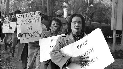 Coretta Scott King, widow of Dr. Martin Luther King, Jr. and one of the women being honored in FSU's MLK week celebration, walks a picket line with others to protest apartheid in South Africa, Nov. 29, 1984, at the South African Embassy in Washington.