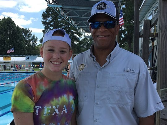 Texas Gold swimmer Becca Rivers, pictured with coach Aubrey Knapper, will be the favorite to win the Iron Woman award at the Damon McCoy Invitational.