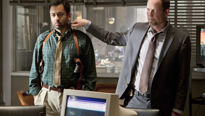 Pictured left to right: Kal Penn as Det. Fontanelle White and Dean Winters as Det. Russ Agnew.