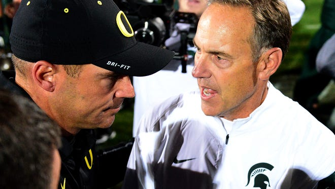 MSU head coach Mark Dantonio, here shaking hands with then-Oregon coach Mark Helfrich, was all smiles after the Spartans 31-28 win over Oregon on Sept. 12, 2015 at Spartan Stadium.