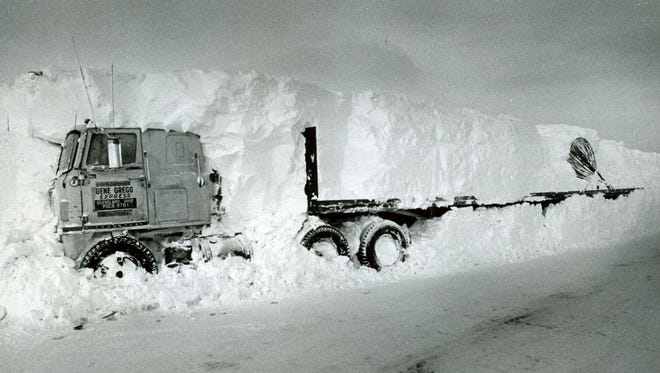 Truck driver James Truly's truck is partially exposed on Ohio 13 north of Mansfield in the wake of the Blizzard of 1978. Truly was trapped in the truck for five days. The story of his rescue was reported around the world.