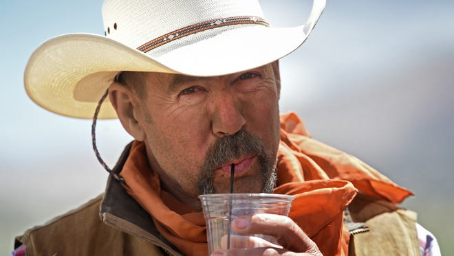 RGJ photographer Andy Barron's portrait of cowboy Randy Lemas enjoying a cold drink after a dusty day on the Reno Rodeo cattle drive won first place in the portrait category of the 2017 Nevada Press Association awards.