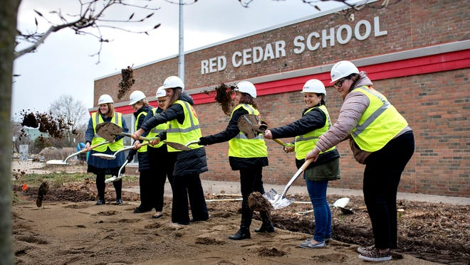From left, East Lansing Public Schools Superintendent Dori Leyko, Board of Education members Nell Kuhnmuench, Terah Chambers, Erin Graham, Karen Hoene, Nichole Martin and Board President Kate Powers during a groundbreaking ceremony on Monday, April 9, 2018, at Red Cedar Elementary School in East Lansing. The school is the first of six planned elementary school construction projects funded by last year's successful $93.7 million bond campaign.