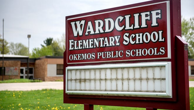 The sign out front of the closed Wardcliff Elementary School on Wednesday, May 9, 2018, in Okemos.
