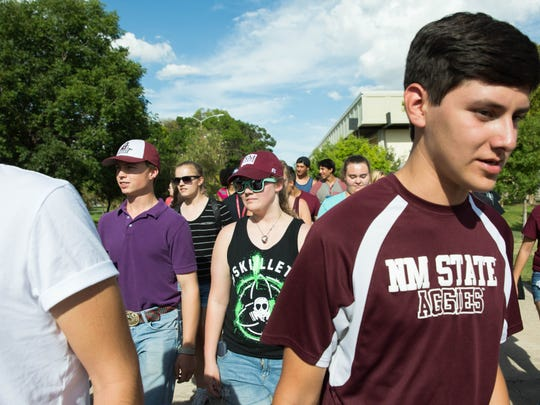 The second, New Mexico State University First Year Walk, where freshman students walk from the Pan American Center down the International Mall. This walk was started for a symolized start of the freshman year. Tuesday Aug. 15, 2017.