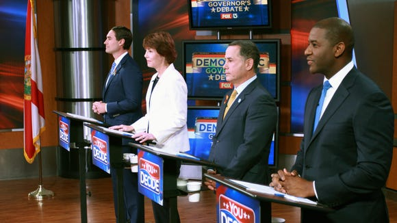 from the right; Tallahassee Mayor Andrew Gillum, Miami Beach Mayor Philip Levine, former Congresswoman Gwen Graham, and businessman Chris King listen to the moderator during the first gubernatorial debate in the Democratic primary, Wednesday, April 18, 2018 in Tampa, Fla. (WTVT Fox 13 via AP, Pool)