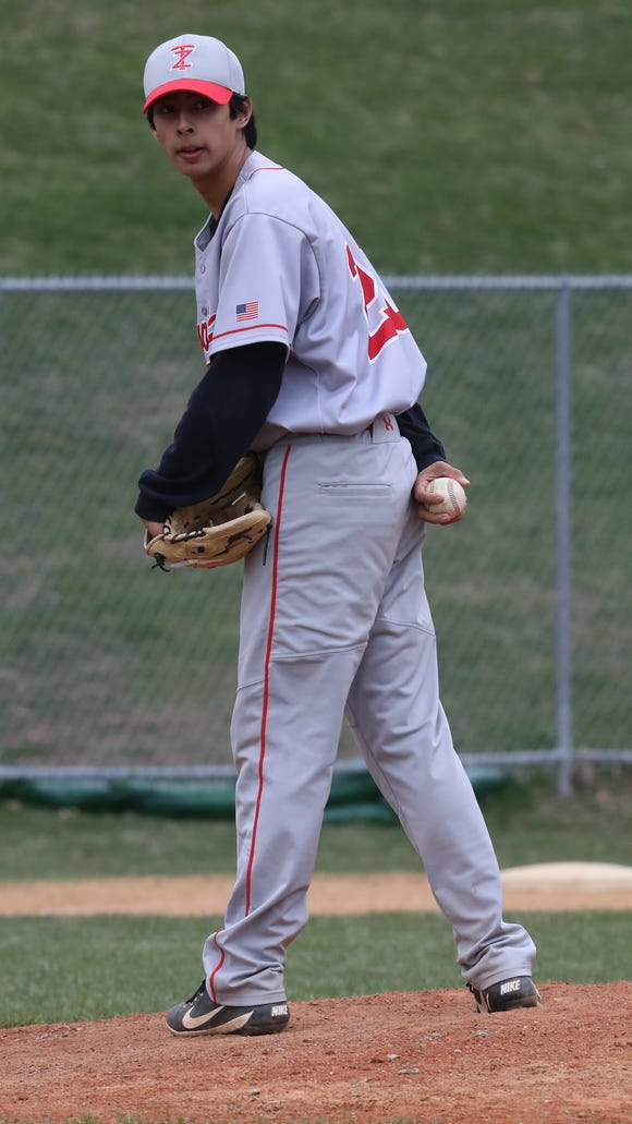 Tappan Zee's Mario Zamora (20) pitches during baseball