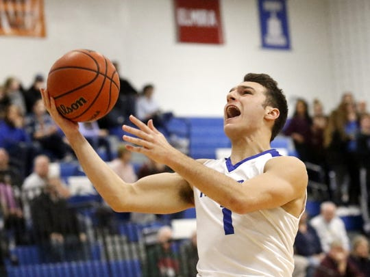 Nico Limoncelli of Horseheads drives in for a layup against Binghamton on Friday at Horseheads Middle School.