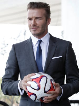 David Beckham has exercised his option to purchase a Major League Soccer expansion team in Miami, and the deal will be finalized when the former English national team captain can secure a financing plan and location for a new stadium.