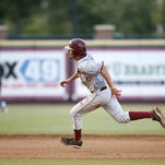 Florida State's Dylan Busby, pictured here sliding safely past Florida's Richie Martin, has moved from third base to first base this season.