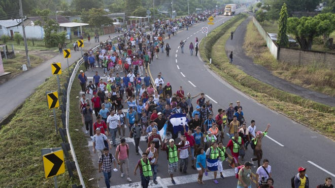 """In this Oct. 21, 2018 photo, Central American migrants walking to the U.S. start their day departing Ciudad Hidalgo, Mexico. Federal immigration and health officials were blindsided by President Donald Trump's """"zero tolerance"""" policy on migrants crossing the southwest border, triggering a cascade of problems as agencies struggled with the fallout from family separations, congressional investigators said in a critical report issued Wednesday. With the White House considering tougher immigration measures as a caravan of migrants slowly heads north from Central America, the GAO report stands as a cautionary tale. (AP Photo/Moises Castillo)"""