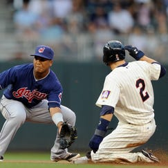 MINNEAPOLIS, MN - AUGUST 20:  Brian Dozier #2 of the Minnesota Twins steals second base as Jose Ramirez #11 of the Cleveland Indians fields the throw during the first inning of the game on August 20, 2014 at Target Field in Minneapolis, Minnesota. (Photo by Hannah Foslien/Getty Images)
