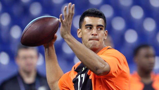The Eagles tried trading up with the Tennessee Titans to draft quarterback Marcus Mariota, shown at the NFL Scouting Combine in 2015.