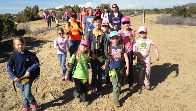 Members of American Heritage Girls troop 2206 hike to see arches in the Aztec area.
