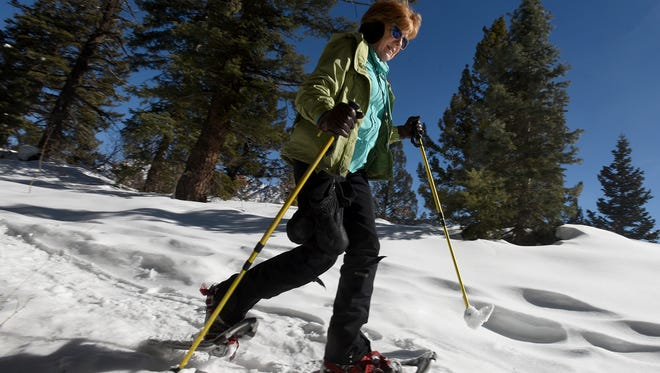 """We come up here every season,"" said Sara Stover, of Flower Mound, Texas, talking about how she and her husband visit Colorado every winter. Stover was out snowshoeing on Friday at the Durango Nordic Center near Purgatory Resort."
