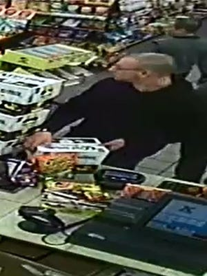Investigators released photos of a male making purchases at a local gas station in Prattville.