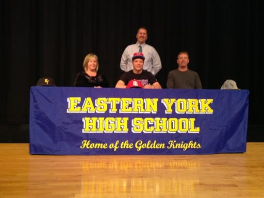 Seated, from left: Kim Godfrey (mother), Terry Godfrey, Blain Godfrey (father). Standing: Eastern York Head Baseball Coach Blaine Garner.
