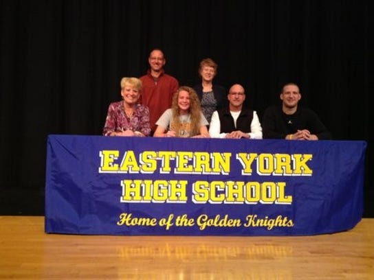 Pictured, from left and seated: Tammy Thomas (mother), Morgan Thomas, Dave Thomas (father), Trent Thomas (brother) Standing: Mike Thomas (uncle), Eastern York Head Girls Basketball Coach Cheryl Land.