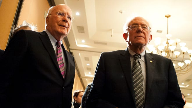Sens. Patrick Leahy, D-Vt., and Bernie Sanders. I-Vt., together on the Senate floor in 2014.