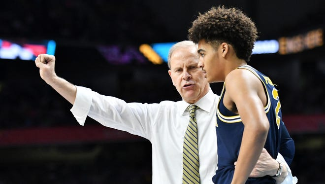 Michigan fans will be able to take a photo with coach John Beilein, left, and sophomore guard Jordan Poole during the team's annual selfie night event.