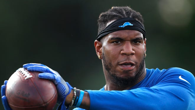 Detroit Lions tight end Eric Ebron catches a pass during NFL football practice in Allen Park, Mich., Monday, Aug. 1, 2016.