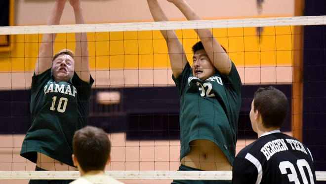 Ben Rickert #10 and Justin Hu #32 of Ramapo go up for a block against Bergen Tech during the Bergen County volleyball tournament semifinals on Tuesday, May 9, 2017. Ramapo defeated Bergen Tech winning the first game 25-19 and the second game 25-16 at Hackensack High School.