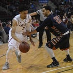 New Mexico State's Matt Taylor, left, tries to dribble around Northern New Mexico's Marcus Ellis during Monday's basketball game in Rio Rancho,