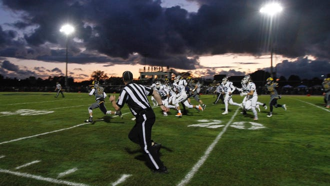 As threatening clouds moved in, Wayne's Billy Thomson broke off an 86-yard touchdown run in the first quarter against East Rochester/Gananda. Weather won early, as lightning delayed the game by for more than an hour and a half.