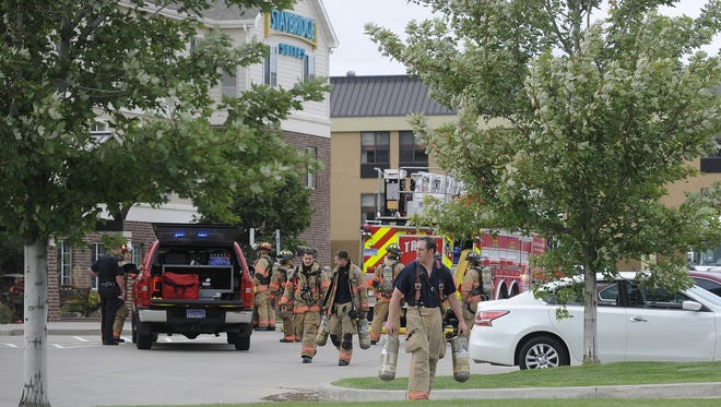 Sioux Falls Fire Rescue respond to heavy smoke in the lobby at Staybridge Suites, 2500 South Carolyn Avenue in Sioux Falls, S.D., Saturday, Sept. 13, 2014.