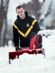 Jared Zimmerman of York City blows snow along Roosevelt