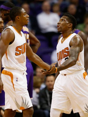 Suns guard Eric Bledsoe (right) high-fives Brandon Knight after scoring against the Los Angeles Lakers during an NBA game at Talking Stick Resort Arena on November 16, 2015 in Phoenix.