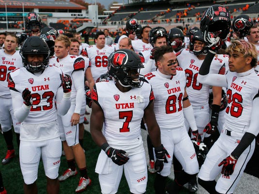 Utah's Julian Blackmon (23), Andre Godfrey (7), Dimitri Salido (81) and Samson Nacua (26) celebrate after Utah's 19-14 victory over Oregon State in an NCAA college football game in Corvallis, Ore., on Saturday, Oct. 15, 2016. (AP Photo/Timothy J. Gonzalez)