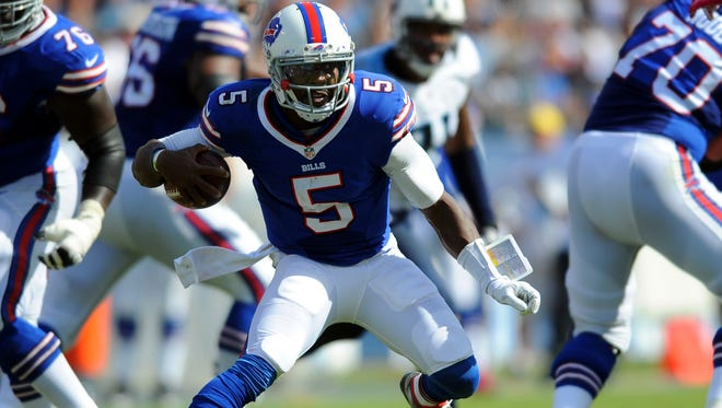 Bills quarterback Tyrod Taylor (5) runs for a first down during the second half against the Tennessee TItans.