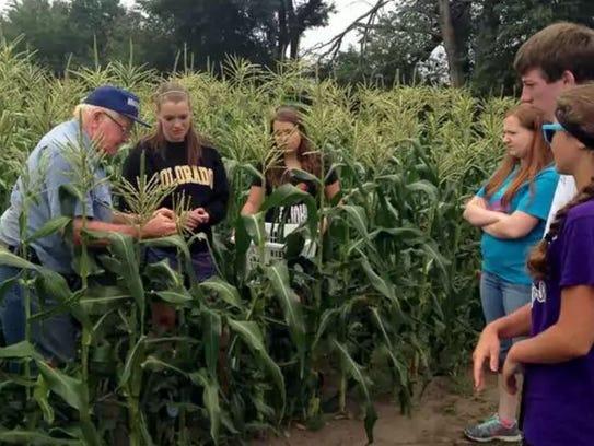 Harold Altenburg talks to students about corn at Altenburg's