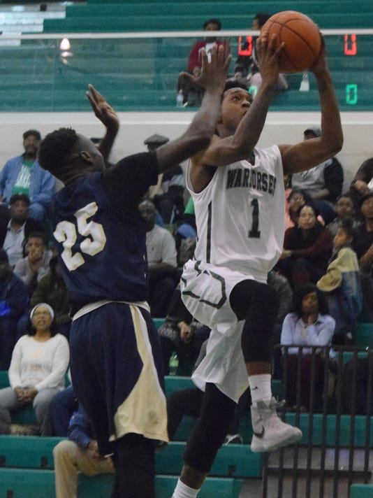 Peabody's Cedric Russell (1, right) shoots over Avoyelles' Myron Robertson (25, left) Friday.