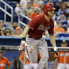 The Diamondbacks' Ender Inciarte runs to first after a bunt single in the sixth inning during a game against the Miami Marlins on Aug. 17, 2014.